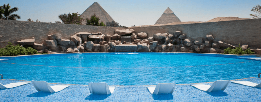 Enjoy pyramid views as you relax around the pool at Le Meridien Pyramids.