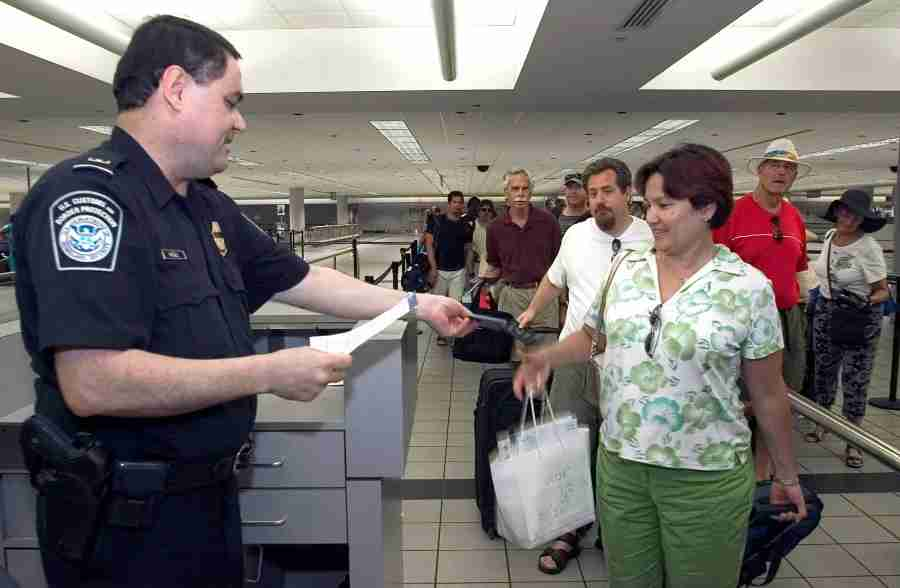 A CBP officer checks a passenger