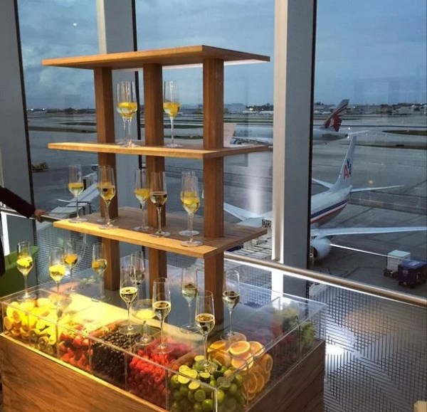 Champagne with a side of airplane views at the Centurion Lounge in Miami.