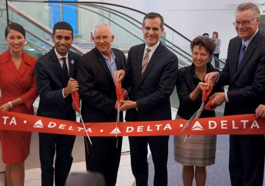 Los Angeles Mayor Eric Garcetti (center) was on hand for the ribbon-cutting ceremony for LAX's new Terminal 5 — including Delta ONE.