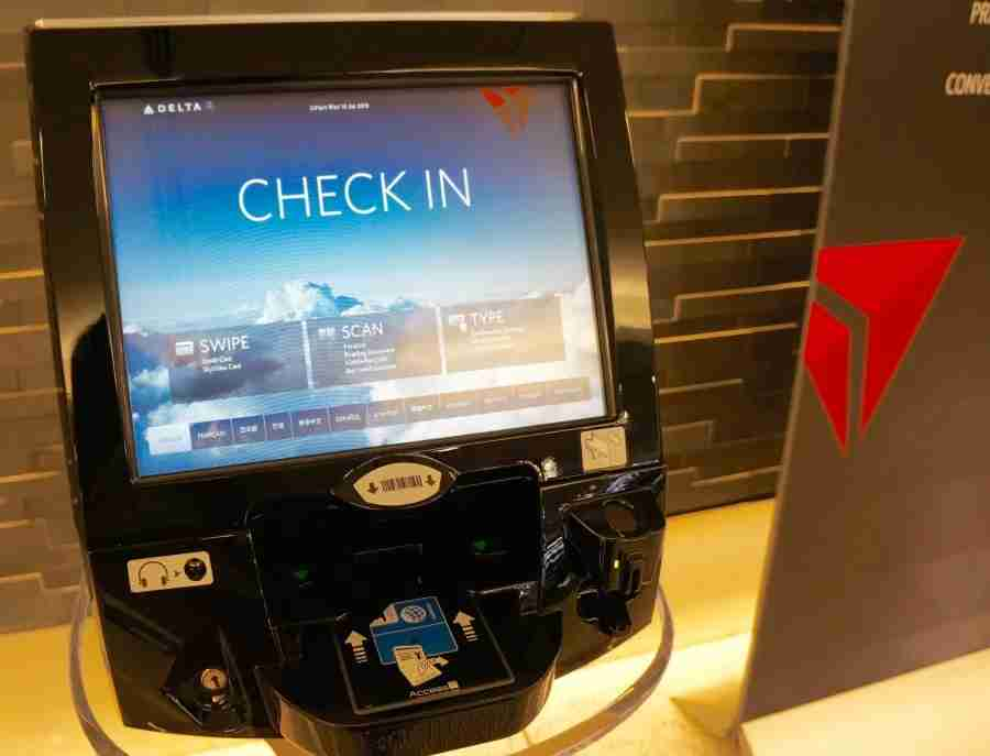 One of three dedicated check-in kiosks at Delta ONE.