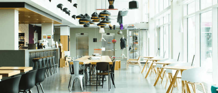 The bright and airy common area of the MOXY Milan Malpensa Airport.