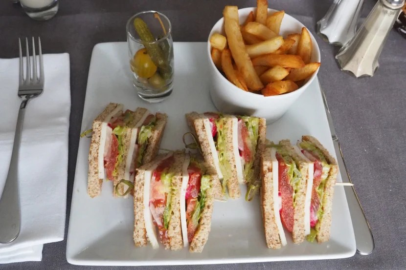Room-service vegetarian club sandwich.