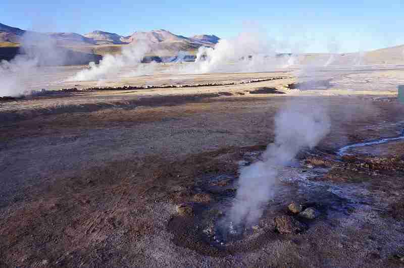 El Tatio Geyser Field lies 14,000 feet above the desert floors — and it