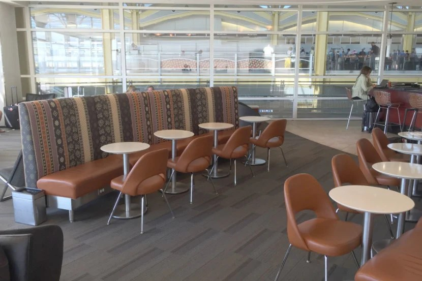 While the other side of the lounge features views of the tarmac, this side overlooks the check-in counters.