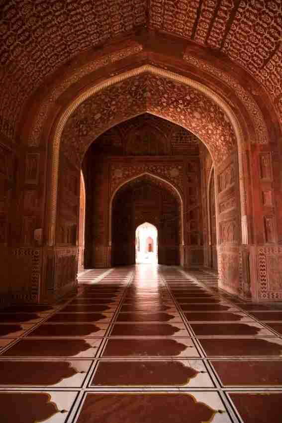 The inside of the mosque that sites to the left of the Taj. Notice the many layers of symmetry and cascading archways