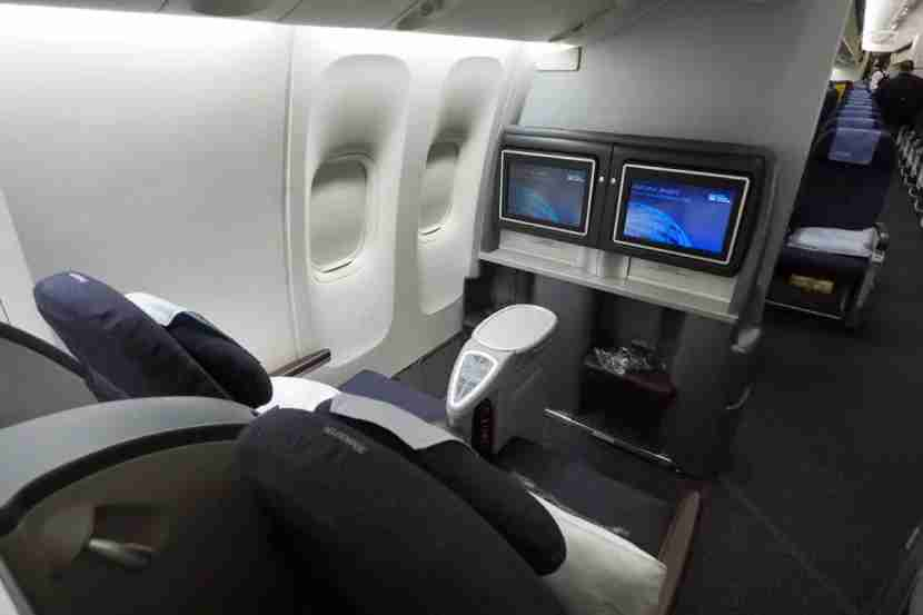 Business-class seats alternate between forward and rear-facing.