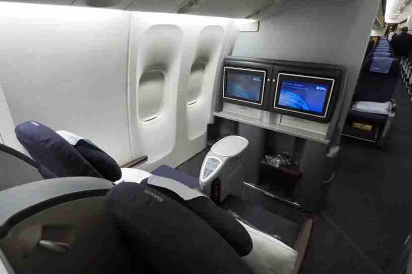Business-class seats alternate between forward and rear-facing.