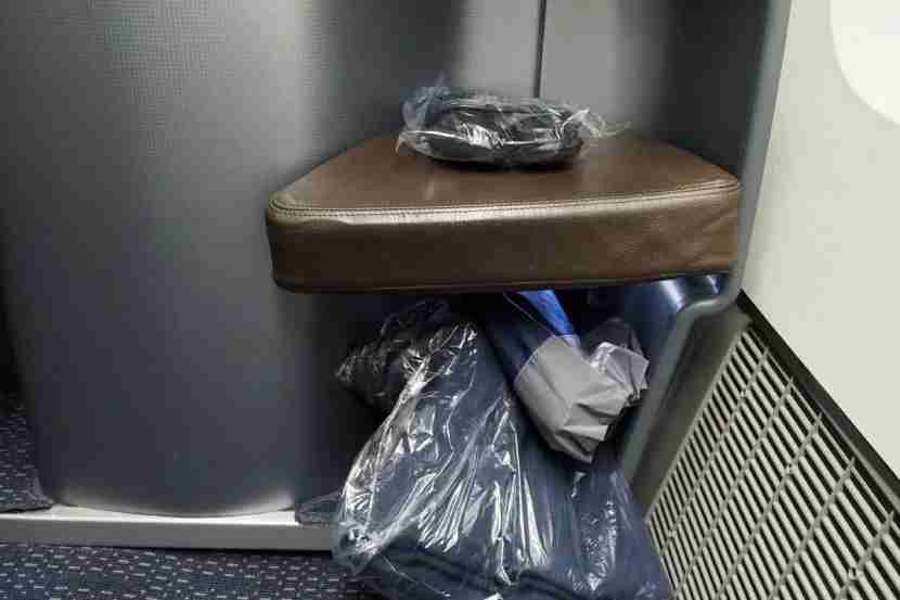 With very little storage in the seat, your bags will most likely be staying in the overhead bin.
