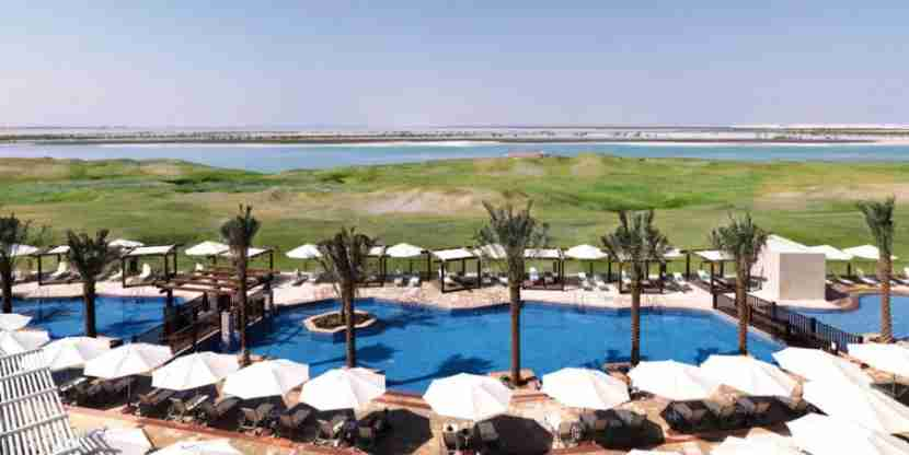 You might just want to spend your whole layover poolside at the Radisson Blu Abu Dhabi. Photo courtesy of the hotel.