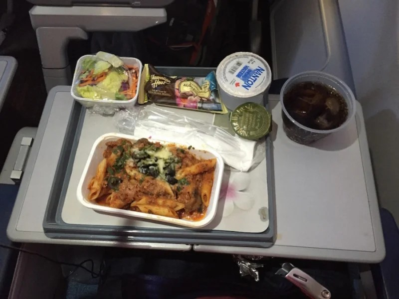 Meal service included pasta with meat sauce, mushrooms and olives along with a side salad and chocolate macadamia nuts.