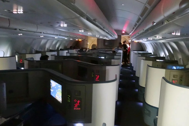 Looking into the 767-300ER Delta One cabin.