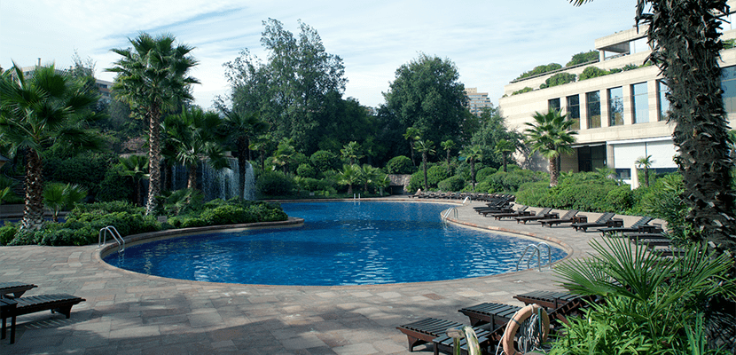 The pool located right outside the lobby.