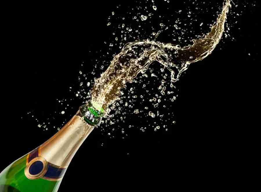 """Image courtesy of <a href=""""http://www.shutterstock.com/pic-120847777/stock-photo--celebration-theme-with-splashing-champagne-isolated-on-black-background.html?src=t-_cug3r7CUG26ugiPaarw-1-53"""" target=""""_blank"""">Shutterstock</a>."""