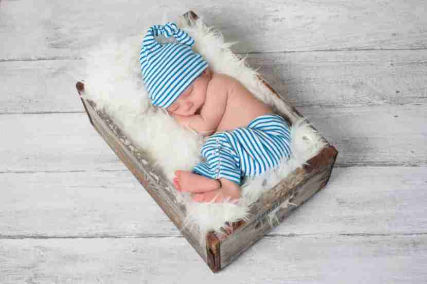 Baby in a box. Photo courtesy of Shutterstock.