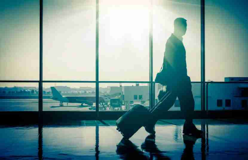 """Photo courtesy of <a href=""""http://www.shutterstock.com/pic-175629032/stock-photo-business-man-at-international-airport-moving-to-terminal-gate-for-airplane-travel-trip-mobility.html?src=cAr2eAZoXO31JQ67qGqqQg-1-11"""">Shutterstock</a>"""