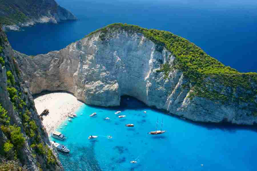 "So beautiful, it might merit some instability. Photo courtesy of <a href=""http://www.shutterstock.com/pic-206795179/stock-photo-amazing-navagio-beach-in-zakynthos-island-greece.html?src=llte-6Q1_CFTWf5RbgaeqQ-1-10"">Shutterstock</a>"