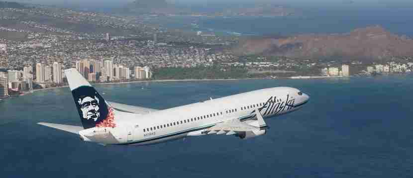 Alaska Airlines plane over Hawaii Oahu banner
