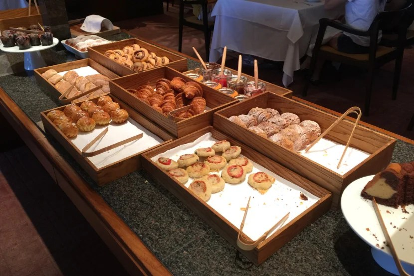The breakfast buffet includes a variety of hot dishes and pastries.