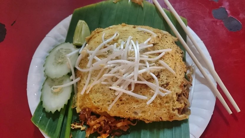 Pad Thai wrapped in egg. Anyone hungry yet?