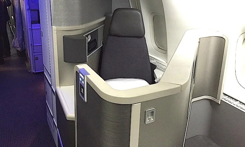 A backward-facing seat at the front of the aft business section.
