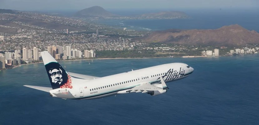 Alaska Airlines plane over Hawaii Oahu featured