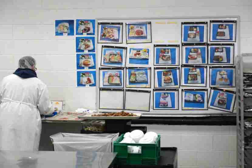 Employees arrange trays based on these presentation photos.