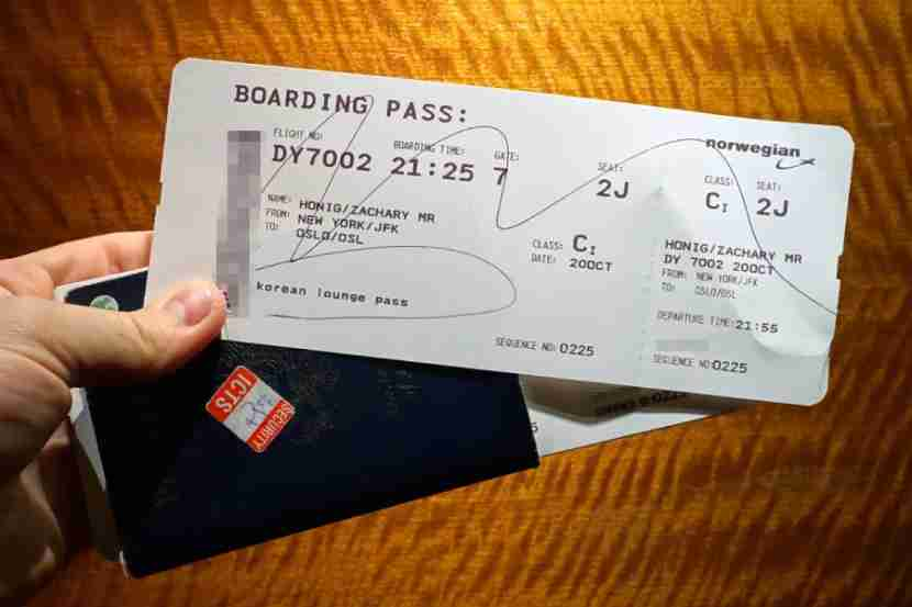 My boarding pass and lounge ticket.