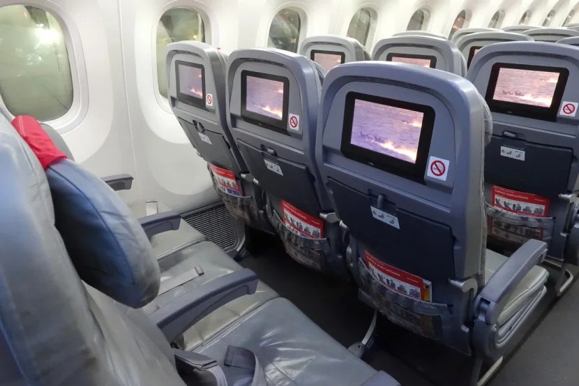 Each seat has an on-demand entertainment system with free movies.