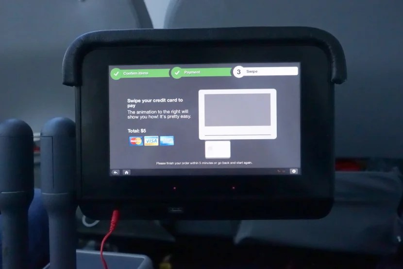 The IFE accepts payments directly, so you don't need to hand your card to a flight attendant.