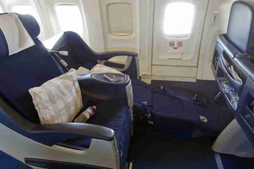 A fully reclined window seat.