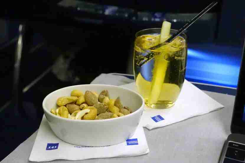 A cocktail and mixed nuts.