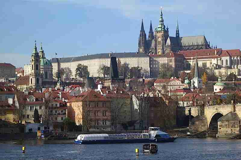 Prague Castle anchors the hills of Malá Strana skyline across the Vltava River.