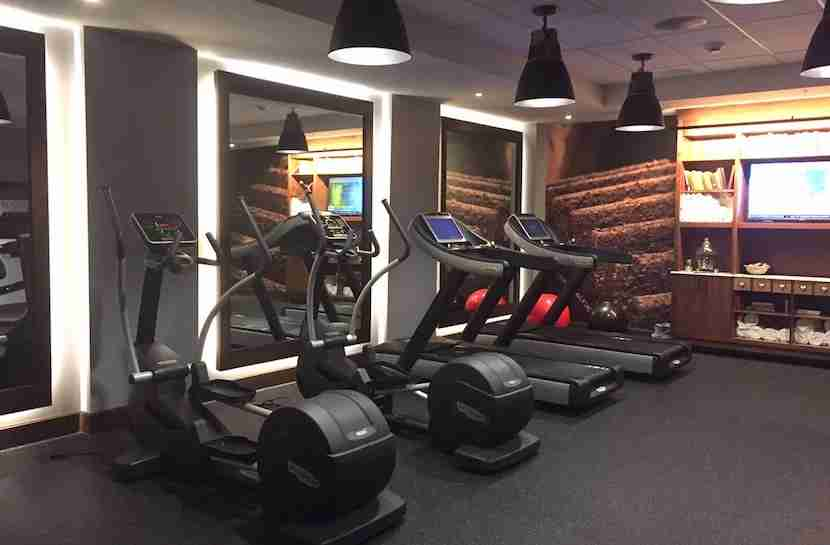 The gym is downstairs in the basement.