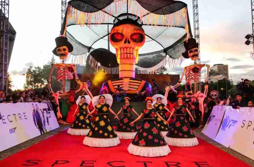 Festive dancers at the Spectre red carpet premiere.