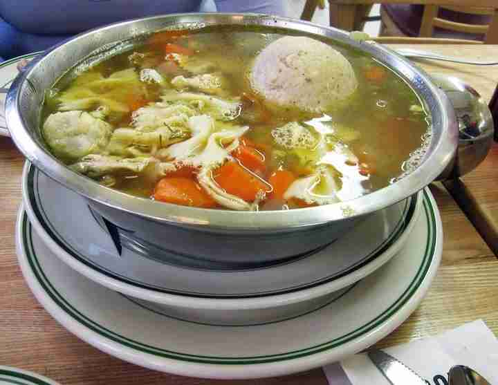 Served with a matzo ball as big as a baseball, the Chicken Soup at Famous 4th Street Delicatessen is for big appetites. Photo from Alice L. on Yelp.
