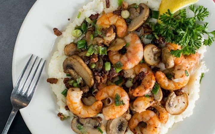 Heralded as the birthplace of Shrimp & Grits, Crook's Corner serves this Southern comfort food to a third of its customers. Photo courtesy of Crook's Corner.