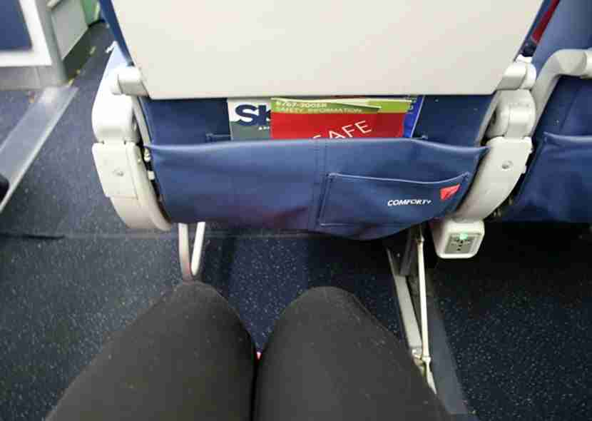 I snuck over to a regular, non-bulkhead Delta Comfort+ seat to test out the legroom, which definitely was a bit roomier.