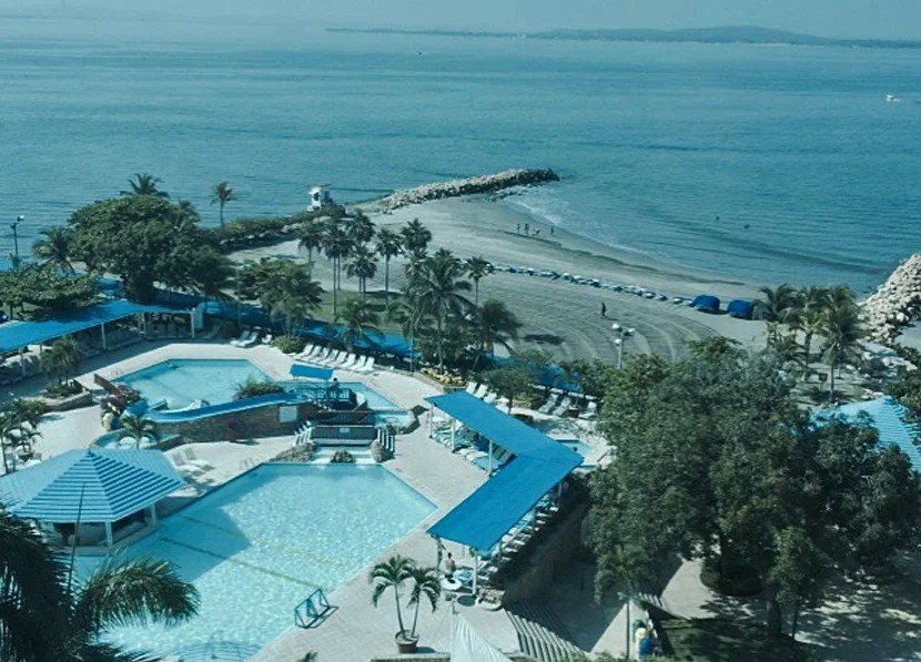 The view of the pools complex and the private beach from our guest room in the Executive Tower.