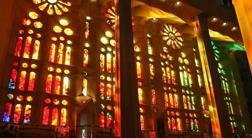 The sunlight streams through the stained glass windows at La Sagrada Família.