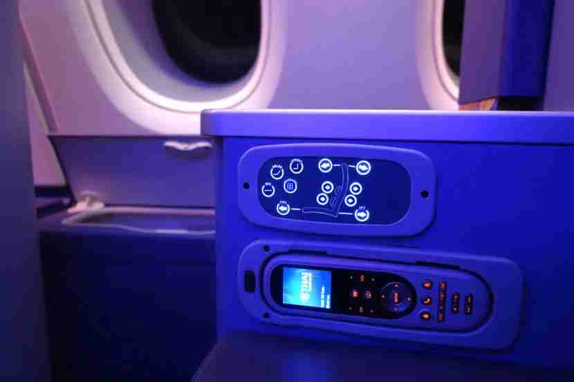 Seat controls are similar to those in first class.