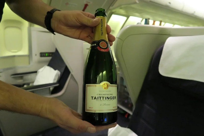 The flight attendants were happy to help you choose between the available champagne options.