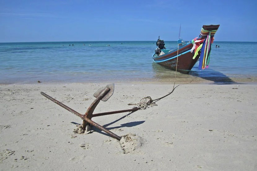 A boat moored along the beach in Koh Phangan.