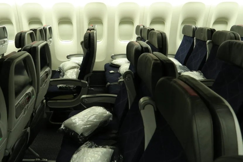 Packaged pillows and blankets were seemingly thrown into the seats before the passengers boarded.