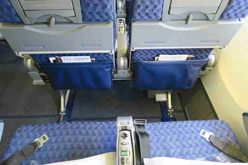 All window seats have limited legroom and under-seat storage due to a large entertainment box.