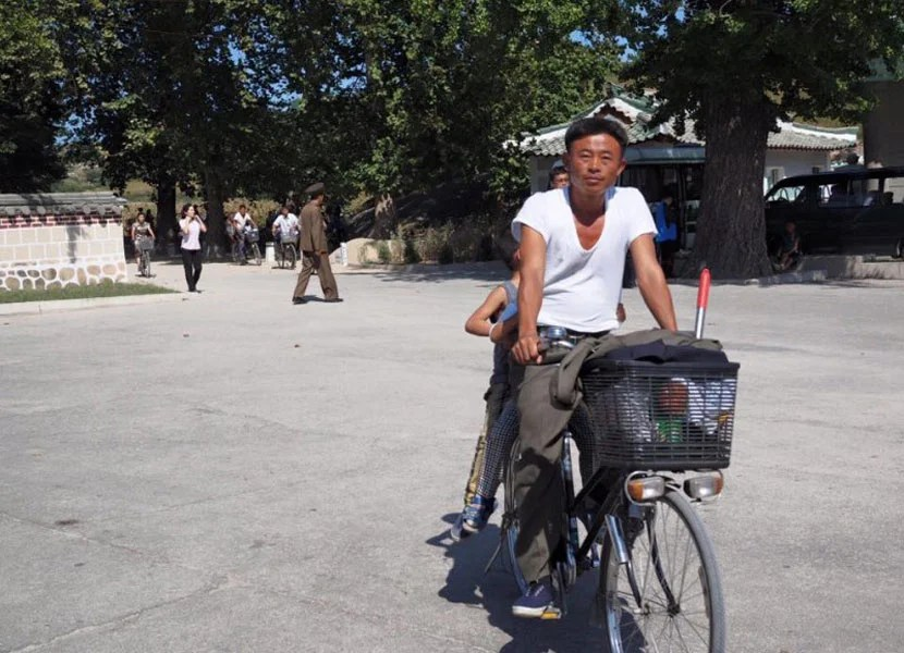 Man on a bike in North Korea.