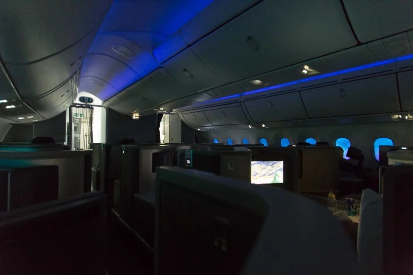 With all of the windows dimmed, there's still a blueish glow throughout the cabin during a daytime flight.