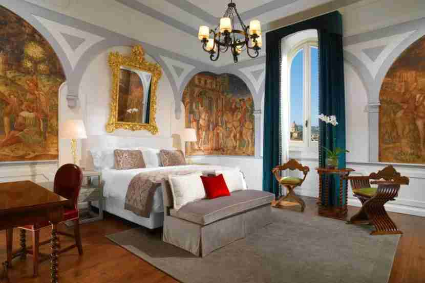 A Premium Deluxe room with an Arno River view at the St. Regis Florence. Image courtesy of Starwood.