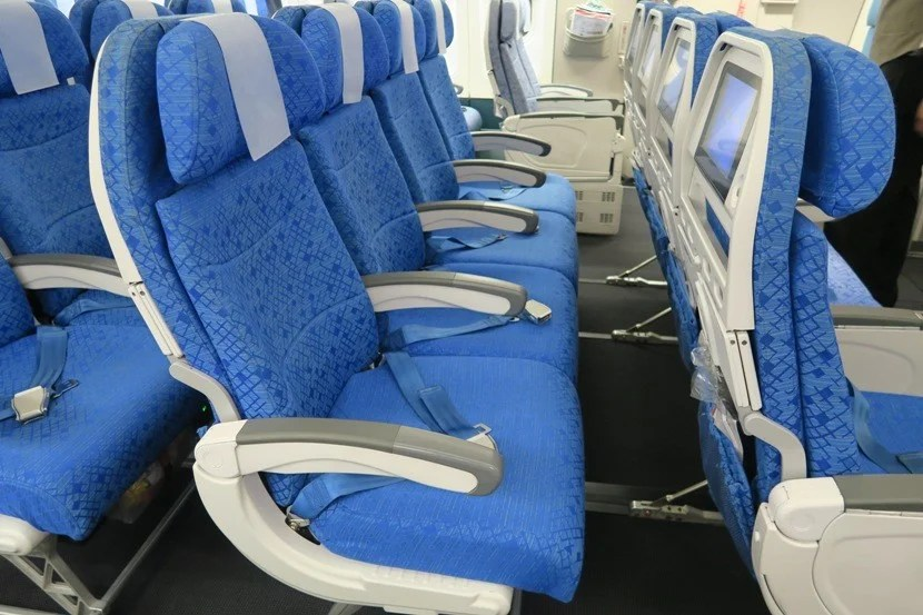 """If you happen to be on an empty flight, the four-seat middle rows couldturn into a nice """"poor man's lay-flat seat."""""""