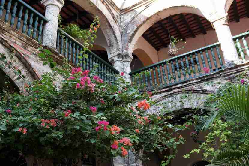 The elegantly faded, bougainvillea-draped courtyard of Convento de la Popa.
